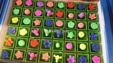 Растущая фигурка в вазоне микс цветов